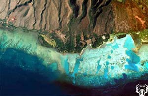 Figure 4. One of the most striking features of the reef flats off Kamalo is the presence of deep �blue holes� as well as an aborted attempt to dredge a harbor (square hole near upper right).